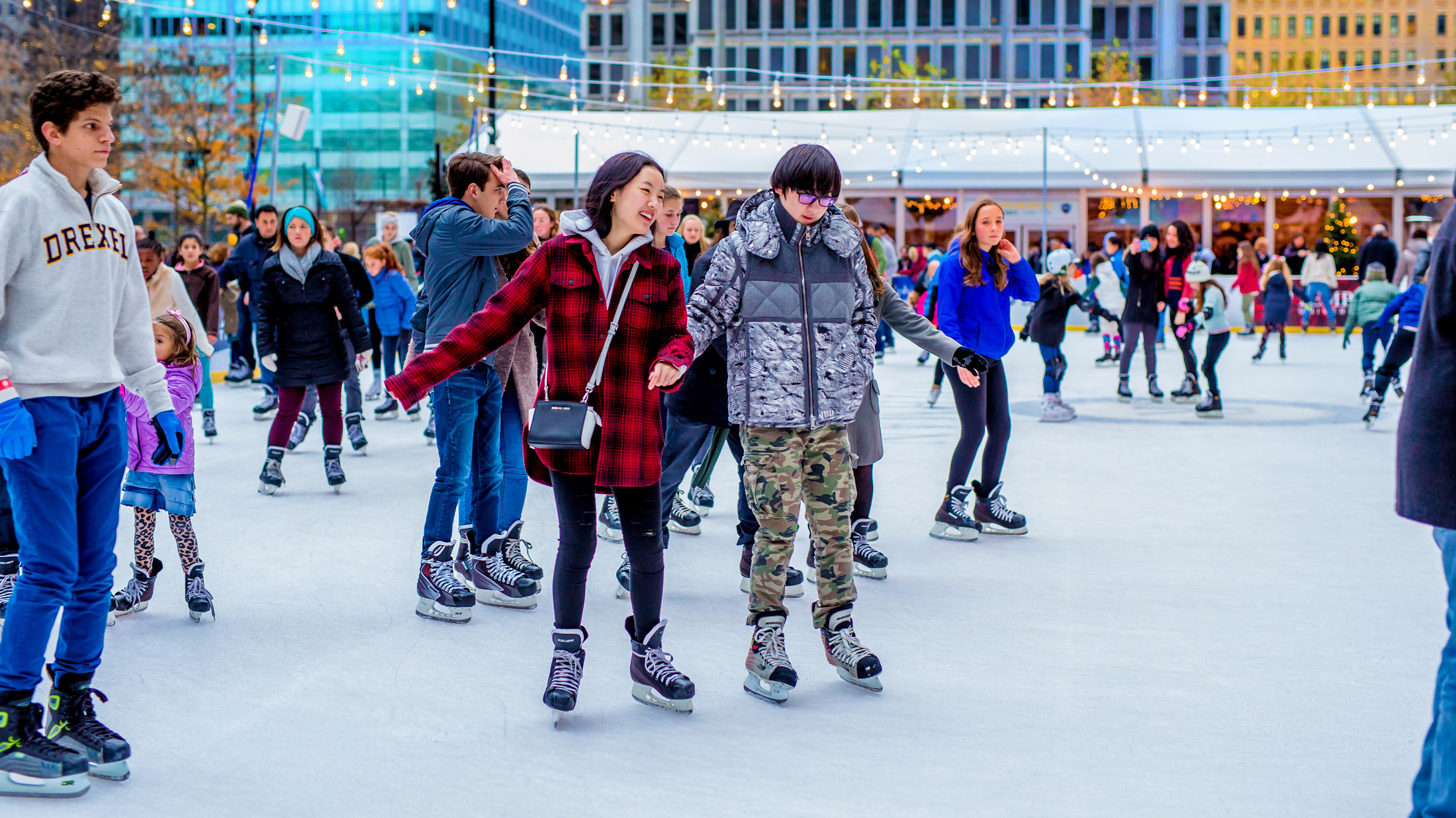 Couple skating at Rothman Ice Rink